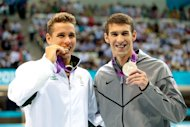 Gold medallist Chad le Clos and silver medallist Michael Phelps of the United States (Getty Images)