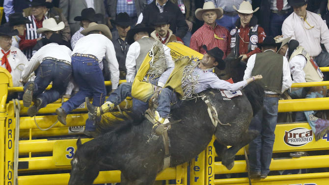 Bobby Mote of Stephenville, Texas rides First Kiss in the 10th go-round of the National Finals Rodeo, Saturday, Dec. 15, 2012, in Las Vegas. (AP Photo/Julie Jacobson)