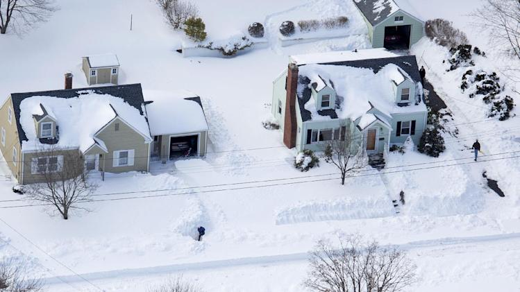 People dig out from an historic snowfall Sunday, Feb. 10, 2013, near Hamden, Conn., in the aftermath of a storm that hit Connecticut and much of the New England states. (AP Photo/Craig Ruttle)