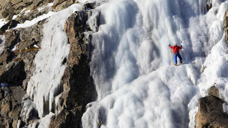A man climbs an ice wall on the Presena glacier