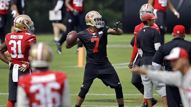 San Francisco 49ers quarterback Colin Kaepernick (7) throws a pass to a receiver during an NFL football training camp practice, Monday, Aug. 11, 2014, in Owings Mills, Md