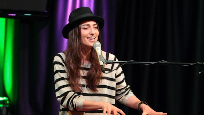 "FILE - In this April 30, 2013 file photo, singer-songwriter Sara Bareilles visits radio station Mix 106 Performance Theater, in Philadelphia. Bareilles says though she doesn't think Katy Perry's ""Roar"" steals from her song ""Brave,"" she's enjoying her tune's newfound success because of the chatter. ""I was stoked. I was like, 'Great,'"" Bareilles said in an interview Tuesday, Sept. 17, 2013. (Photo by Owen Sweeney/Invision/AP, File)"