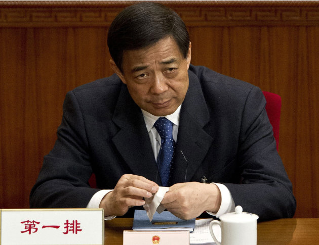 FILE - In this March 11, 2012 file photo, then Chongqing party secretary Bo Xilai attends a plenary session of the National People's Congress at the Great Hall of the People in Beijing. Bo's wife Gu K