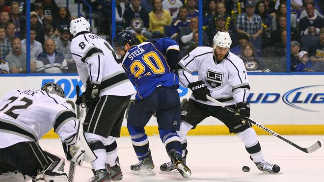 Rob Scuderi #7 Of The Los Angeles Kings Looks To Clear The Puck Against The St. Louis Blues In Game One Of The Western Getty Images
