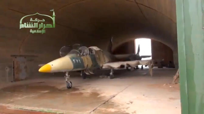 This image taken from video obtained from Ugarit News, which has been authenticated based on its contents and other AP reporting, shows a Syrian fighter jet in a hangar after rebels captured Jarrah airfield in Aleppo province, Tuesday, Feb. 12, 2013. Rebels captured a military air base in northern Syria on Tuesday, their second major strategic victory in as many days, activists said.(AP Photo/Ugarit News via AP video)
