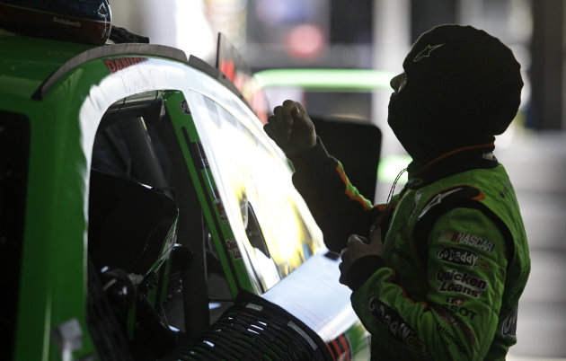 Danica Patrick prepares to climb into her car during practice for Sunday's NASCAR Sprint Cup series Coca-Cola 600 auto race at Charlotte Motor Speedway in Concord, N.C., Thursday, May 23, 2013. (AP Ph