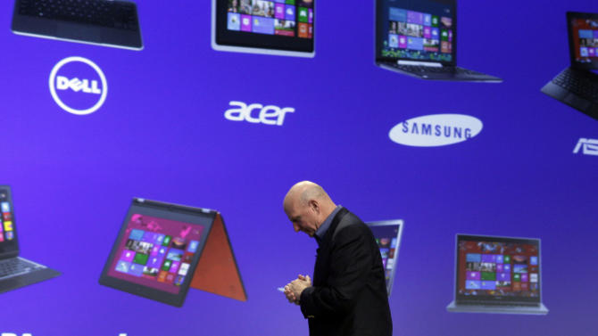 Microsoft CEO Steve Ballmer walks in front of a screen of computer manufacturers after his presentation at the launch of Microsoft Windows 8, in New York,  Thursday, Oct. 25, 2012. Windows 8 is the most dramatic overhaul of the personal computer market's dominant operating system in 17 years. (AP Photo/Richard Drew)