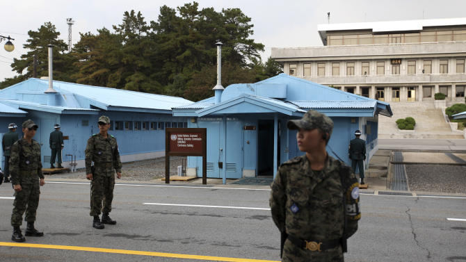 South Korean soldiers stand guard at the border village of  Panmunjom that separates the two Koreas since the Korean War, in Paju, north of Seoul, South Korea, Tuesday, Oct. 9, 2012. North Korea on Tuesday warned that the U.S. mainland is within range of its missiles, and said Washington's recent agreement to let Seoul possess missiles capable of hitting all of the North shows the allies are plotting to invade the country. (AP Photo/Hye Soo Nah)