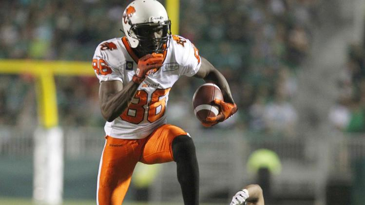 BC Lions' slotback Taylor gets away from Saskatchewan Roughriders' corner back Maze to score a touchdown during their CFL football game in Regina