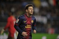 Barcelona forward Lionel Messi looks on during the Spanish Copa del Rey quarter-final match against Malaga at the Rosaleda stadium in Malaga on January 24, 2013. Lionel Messi has signed a new contract that will tie him to Barcelona until 2018