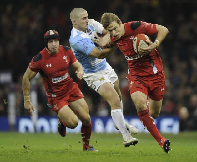 Wales' Liam Williams pushes away Argentina's Santiago Cordero during their international rugby union match at the Millennium Stadium in Cardiff