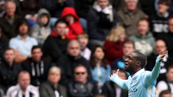 Manchester City's Yaya Toure, celebrates his goal during their English Premier League soccer match against Newcastle United at the Sports Direct Arena, Newcastle, England, Sunday, May 6, 2012. (AP Photo/Scott Heppell)