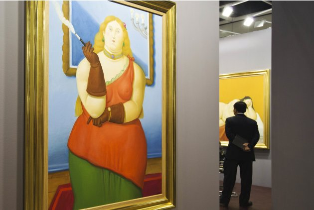 A painting by Colombian artist Fernando Botero is displayed during a preview of the first Art Basel in Hong Kong