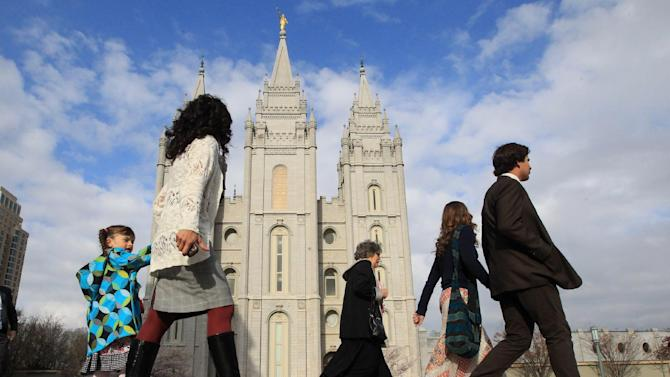 "FILE - In this April 5, 2014 file photo, people walk past the Salt Lake Temple in Salt Lake City. On Tuesday, Jan. 27, 2015, Mormon leaders made a national appeal for what they called a ""balanced approach"" in the clash between gay rights and religious freedom, promising to support some housing and job protections for gays if they back some exemptions for religious objectors to same-sex marriage. (AP Photo/Rick Bowmer)"