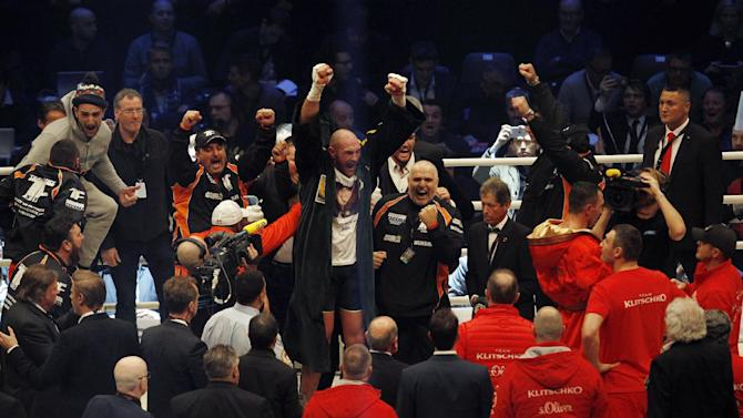 Tyson Fury celebrates after being declared the winner of the fight  as Wladimir Klitschko looks dejected