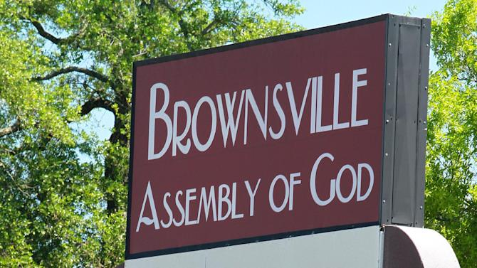 This March 25, 2012, photo, shows the exterior of the Brownsville Assembly in Pensacola, Fla. The church that was home to the largest Pentecostal outpouring in U.S. history is on the edge of financial ruin. The revival that drew some 5,500 people nightly at its height saddled the congregation with an $11.5 million debt that members were left to pay off after both the out-of-town throngs and former Rev. John Kilpatrick moved on. The red ink is mostly unknown outside the congregation. (AP Photo/John David Mercer)
