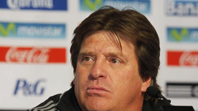 Mexico's national soccer team coach Miguel Herrera speaks to journalists during a news conference in Mexico City