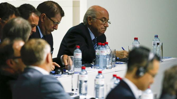 FIFA president Blatter writes during the election process at the 65th FIFA Congress in Zurich