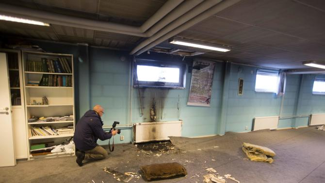 A police officer investigates a suspected arson in the basement of a mosque in the southern Swedish town of Eslov