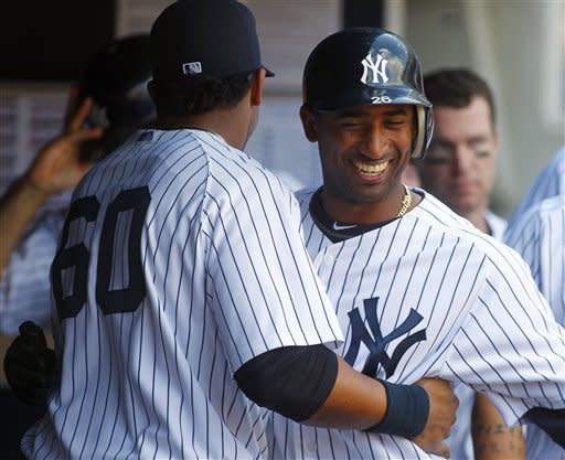 Hardy's error helps Yankees rally past Orioles 4-3