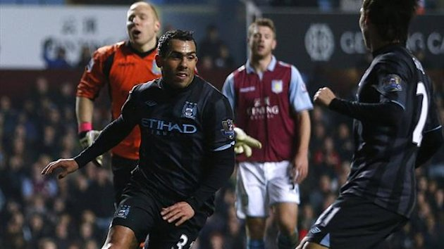 Carlos Tevez scores for Manchester City against Aston Villa (Reuters)