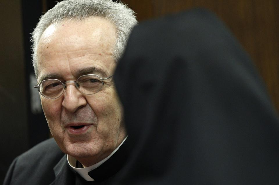 Cardinal Justin Rigali meets with a nun after a news conference Tuesday, July 19, 2011, in Philadelphia.  The Vatican on Tuesday named Chaput as Rigali's successor as Archbishop of Philadelphia. (AP Photo/Matt Rourke)