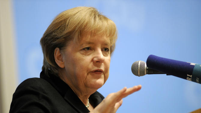 "German chancellor Angela Merkel speaks at a regional meeting of her Christian Democratic Party in Sternberg, eastern Germany Saturday Nov. 3, 2012.  Merkel said  Europe's sovereign debt crisis will last at least five more years and the continent is on the right path to overcome the crisis but ""whoever thinks this can be fixed in one or two years is wrong.""    (AP Photo/dapd/ Thomas Haentzschel)"