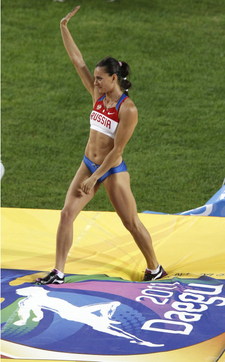 Russia's Yelena Isinbayeva waves to the spectators following a failed attempt in the Women's Pole Vault final at the World Athletics Championships in Daegu, South Korea, Tuesday, Aug. 30, 2011. Isinba