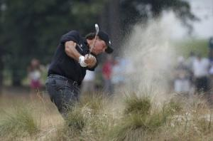 Mickelson of the U.S. a shot from the rough on the 12th hole during the first round of the U.S. Open Championship golf tournament in Pinehurst,