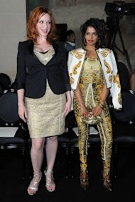 Christina Hendricks vs M.I.A in gold Versace at Paris Fashion Week