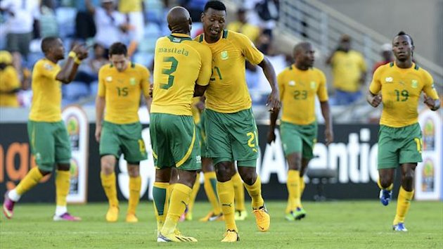 South Africa&#39;s Defender Siyabonga Sangweni (R) celebrates with a team mate after scoring a goal during the South Africa vs Angola Africa Cup of Nations 2013 group A football match at Moses Mahiba Stadium in Durban on January 23, 2013 (AFP)