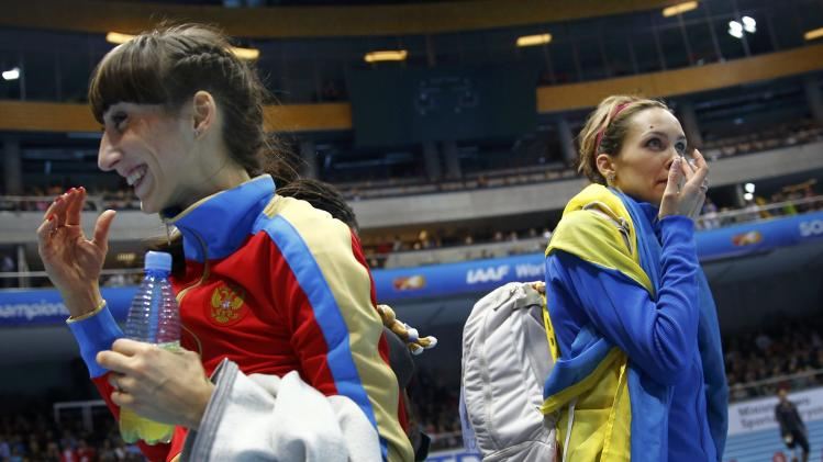 Russia's Koneva celebrates winning gold next to silver medallist Ukraine's Saladukha after women's triple jump final at world indoor athletics championships in Sopot