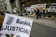<p>Evicted people occupy the sidewalk in front of Spanish bank Bankia's headquarters on Plaza Celenque on October 24 in Madrid. Small groups of Spaniards evicted out of their homes sit in shifts outside a branch of Caja Madrid, part of the Bankia group bailed out by the Spanish state.</p>