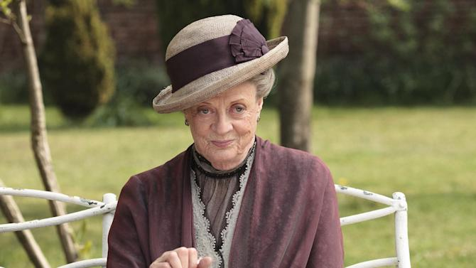 """In this image released by PBS, Maggie Smith as the Dowager Countess Grantham, is shown in a scene from the second season on """"Downton Abbey.""""  The 78-year-old actress, who portrays Lady Grantham in the popular PBS series, told """"60 Minutes"""" that she hasn't watched the drama because doing so would only make her agonize over her performance. She said she may watch it someday. (AP Photo/PBS, Carnival Film & Television Limited 2011 for MASTERPIECE, Nick Briggs)"""