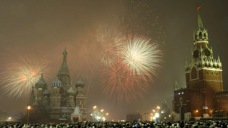 FILE - In this Saturday, Jan. 1, 2011 file photo, Russians celebrate the New Year on Red Square in Moscow, with Kremlin's Spassky Tower right, and St. Basil Cathedral in background left. An Islamist terrorist who plotted to organize suicide bombings on Moscow's iconic Red Square on New Year's eve has been sentenced to 15 years in jail. Ilyas Saidov brought explosives-laden belts disguised as electric heaters for two female suicide bombers who planned to blow themselves on Dec. 31, 2010. But the belt attached to a cell phone exploded at a rented apartment because of a spam text message, killing one of the women and prompting the arrest of the other one. (AP Photo/Misha Japaridze)