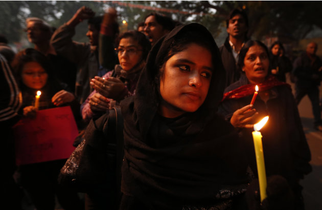 FILE - In this Dec. 26, 2012 file photo, Indians participate in a candle light vigil to seek a quick recovery of the young victim of the recent brutal gang-rape in a bus in New Delhi, India. A stateme
