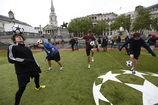 Some of the world's top sixteen soccer freestylers demonstrate their skills at Trafalgar Square in London as Boussia Dortmund and Bayern Munich supporters arrive in London ahead of their Champions Lea