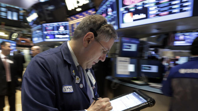 Trader Warren Meyers works on the floor of the New York Stock Exchange Tuesday, March 19, 2013. A surprisingly strong increase in new home construction is sending stocks higher in early trading on Wall Street. (AP Photo/Richard Drew)