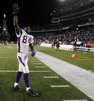 FILE - This Oct. 31, 2010 file photo shows Minnesota Vikings wide receiver Randy Moss waving to the fans after his former team, the New England Patriots, defeated the Vikings 28-18 in an NFL football game in Foxborough, Mass. Moss is calling it a career after 13 seasons in the NFL as one of the most dynamic and polarizing players the league has ever seen. Moss's agent, Joel Segal, said Monday, Aug. 1, 2011,  that the receiver was considering offers from several teams, but made the decision to retire. (AP Photo/Winslow TownsonFile)