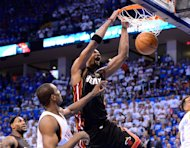 OKLAHOMA CITY, OK - JUNE 14:  Chris Bosh #1 of the Miami Heat dunks the ball over Serge Ibaka #9 of the Oklahomia City Thunder in the fourth quarter in Game Two of the 2012 NBA Finals at Chesapeake Energy Arena on June 14, 2012 in Oklahoma City, Oklahoma. NOTE TO USER: User expressly acknowledges and agrees that, by downloading and or using this photograph, User is consenting to the terms and conditions of the Getty Images License Agreement.  (Photo by Ronald Martinez/Getty Images)
