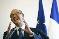 French Finance Minister Pierre Moscovici, seen on September 17, has pledged to get the country's deficit back to within EU limits by next year. France has unveiled action to plug a 37-billion-euro hole in its public finances with the toughest package of tax rises and spending cuts the country has known in an economic downturn