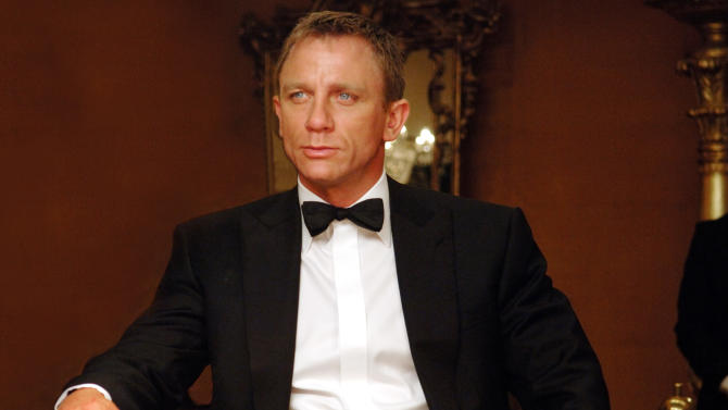 "FILE - This undated publicity file photo released by Sony Pictures shows actor Daniel Craig, who makes his debut as James Bond in ""Casino Royale,"" (2006), a tale of the super-spy's early escapades trying to foil a terrorist gang. Craig can seriously act, bringing a welcome darkness to the character as well as being sexy, masculine and formidable in all the necessary ways. (AP Photo/Sony Pictures, Jay Maidment, File)"