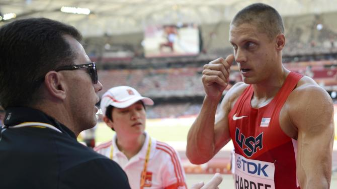 Hardee of the U.S. speaks to his coach after getting injured in the long jump event of the men's decathlon during the 15th IAAF World Championships at the National Stadium in Beijing
