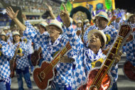 Performers from the Unidos de Vila Isabel samba school parade during Carnival celebrations at the Sambadrome in Rio de Janeiro, Tuesday, Feb. 12, 2013. Rio de Janeiro's samba schools vied for the title of the year's best in an over-the-top, all-night-long Carnival parade at the city's iconic Sambadrome. (AP Photo/Felipe Dana)