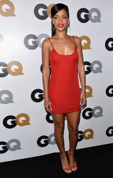 Rihanna: The current GQ cover star takes a cue from Garth by donning the same hue but keeps it simple in a Calvin Klein spaghetti-strap mini dress. The 24-year-old displayed her toned legs and cute ph