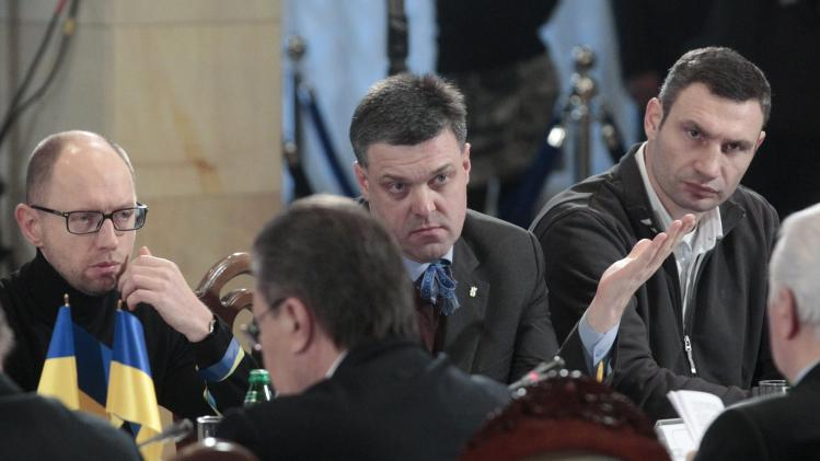 Ukrainian opposition leaders Tyagnibok, Yatsenyuk and Klitschko sit in front of President Yanukovich during a meeting in Kiev