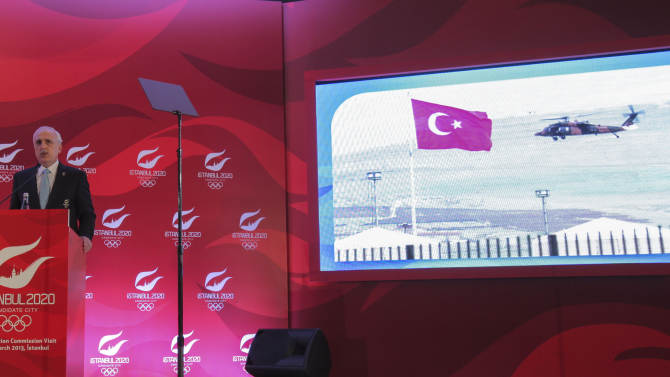"Istanbul Governor Huseyin Avni Mutlu speaks about his city's bid to host the 2020 Olympics during a news conference in Istanbul, Turkey, Wednesday, March 27, 2013. The International Olympic Committee, IOC, vice president Craig Reedie said the IOC has an ""excellent impression"" of the Istanbul committee's bid to host the 2020 Olympics. Reedie was speaking Wednesday as the IOC's evaluation commission wrapped-up a four-day tour to assess Istanbul's ability to host the 2020 Olympic Games. Istanbul is competing against Madrid and Tokyo. (AP Photo)"