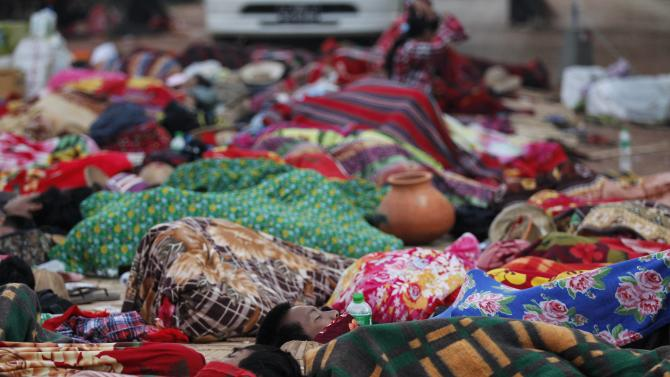 Student protesters sleep on the street during a protest against an education bill in Letpadan
