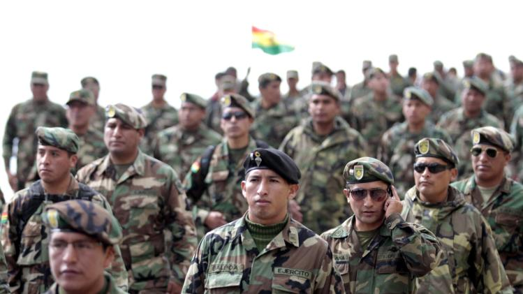 Bolivian low ranking Army officers march during the third day of protest from El Alto to La Paz