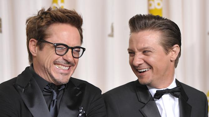 Presenters Robert Downey Jr., left, and Jeremy Renner pose during the Oscars at the Dolby Theatre on Sunday Feb. 24, 2013, in Los Angeles. (Photo by John Shearer/Invision/AP)